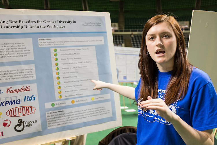 Liz Doyle, a senior in Honors Tutorial College, discusses here research during the Ohio University Student Expo on Thursday, April 10, 2015.   Photo by Ohio University / Rob Hardin
