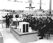 Doctor George Mueller gives Saturn V orientation to United States President John F. Kennedy and officals in Blockhouse 37 at Cape Canaveral, Florida. Front row, left to right: George Low, Doctor Kurt Debus, Doctor Robert Seamans, James Webb, President Kennedy, Doctor Hugh Dryden, Doctor Wernher von Braun, General Leighten Davis, and  United States Senator George Smathers (Democrat of Florida). .Credit: NASA via CNP