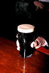 Ireland: Irish drink, Pint of Guinness beer   .Photo: irwest105.Photo copyright: Lee Foster, www.fostertravel.com, 510-549-2202, lee@fostertravel.com