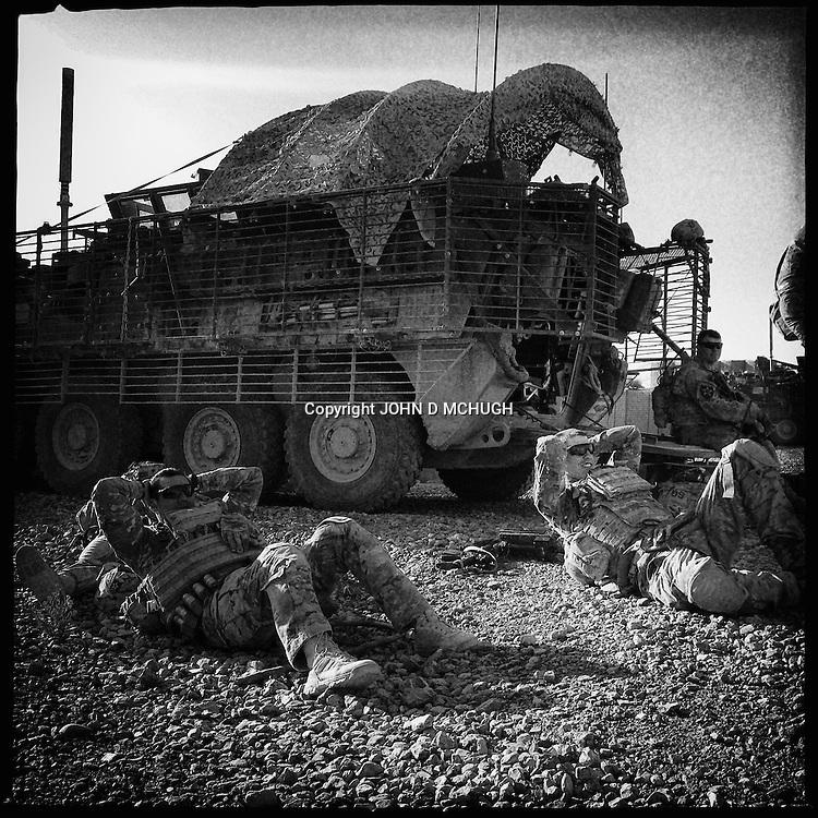 US troops from 1-38 Infantry take a quick break before starting patrol of Pay-E Moluk village in Panjwayi, Kandahar, 30 April 2013. (John D McHugh)
