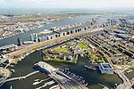 Nederland, Noord-Holland, Amsterdam, 09-04-2014;<br /> Overzicht Marineterrein en omgeving, het Scheepvaartmuseum, Kattenburg, Zeeburg, Wittenburg,  rechts bedrijvenverzamelterrein Init, beneden de IJtunnel en museum Nemo. Boven in beeld het IJ, Java- en KNSM-eiland en de Piet Heinkade met spoorbaan (parkeerterrein Fyra).<br /> View Navy area and the National Maritime Museum (white building), and the eastern part of the city. Right the railroad and the international Fyra trains, waiting. <br /> luchtfoto (toeslag op standard tarieven);<br /> aerial photo (additional fee required);<br /> copyright foto/photo Siebe Swart