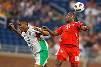 7 June 2011: Panama forward Lluis Tejada (18) heads the ball over Guadeloupe midfielder David Fleurival (6) during the CONCACAF soccer match between Panama and Guadeloupe at Ford Field Detroit, Michigan.