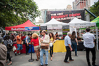 Visitors to the HBO Bryant Park Summer Film Festival in New York partake in free popcorn and buy food at concessions in New York on Monday, July 11, 2016. The park shows films on Monday evenings during the summer attracting a wide range of visitors and up to an estimated 8000 people. (© Richard B. Levine)