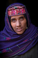 A Bakarwal Gujjar woman with her traditional embroidered hat, or tope.