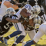 Oakland Raiders middle linebacker Perry Riley (54) tackles Indianapolis Colts running back Robert Turbin (33) on Saturday, December 24, 2016, at O.co Coliseum in Oakland, California.  The Raiders defeated the Colts 33-25.