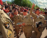 June 5th, 1994--Al Diaz/Herald staff--Airborne veterans D.L. Reyman, at center, and Elsworth Harger, flashing a victory sign, march into Ste. M`ere-Eglise after they parachuted earlier during ceremonies for the 50th Anniversary of D-Day on June 5th 1994