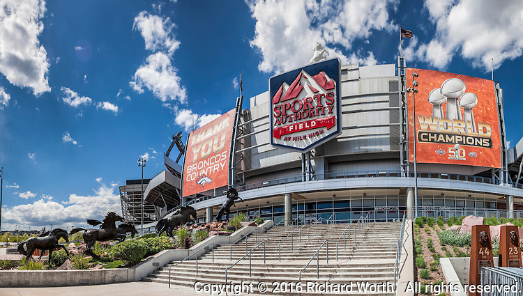 A panoramic composite of images of the Denver Mile High Stadium's main entrance.  One day earlier, on May 18th, Sports Authority confirmed all of its stores would be closing, leaving unanswered its logo affiliation at Mile High Stadium.