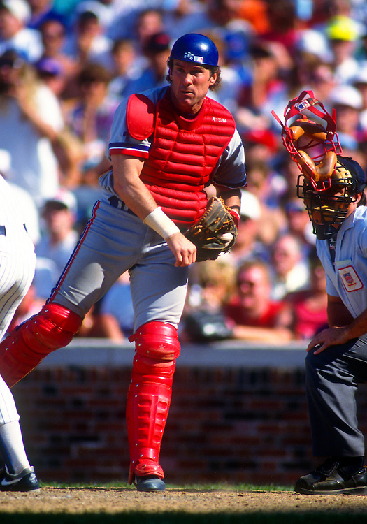 CHICAGO - 1992:  Gary Carter of the Montreal Expos throws the ball toward third base during an MLB game against the Chicago Cubs at Wrigley FIeld in Chicago, Illinois.  Carter played for the Expos from 1974-1984 and again in 1992.  (Photo by Ron Vesely)