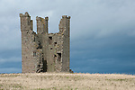 The spectacular ruins of Dunstanburgh Castle, on a headland just north from the village of Craster. Northumberland, UK