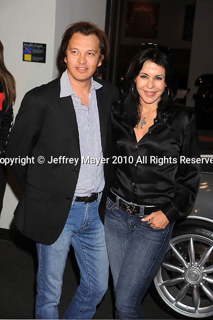 LOS ANGELES, California - May 24: Maria Conchita Alonso (R) and Fernando Barrera attend the Rally For Kids With Cancer Scavenger Cup Press Conference With Eva Longoria at the Petersen Automotive Museum on May 24, 2010 in Los Angeles, California.