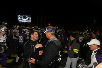 UST coach Glenn Caruso congratulates Larry Kehres on his 10th Stagg Bowl victory in 16 tries.