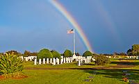 A double rainbow appears over the Maui Veterans Cemetery (or Makawao Veterans Cemetery), Makawao, Maui.