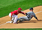 26 September 2010: Atlanta Braves catcher Brian McCann slides safely into third ahead of the throw to Alberto Gonzalez during game action against the Washington Nationals at Nationals Park in Washington, DC. The Nationals defeated the pennant-seeking Braves 4-2 to take the rubber match of their 3-game series. Mandatory Credit: Ed Wolfstein Photo