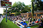 Unplugged at the Grove at Shady Grove, Austin Texas, June 18, 2009.  Shady Grove has been the site of the controversy regarding Austin's noise policy versusits  live music reputation.  A single noise complaint shut down the popular Unplugged at the Grove series one week before this photo was taken.