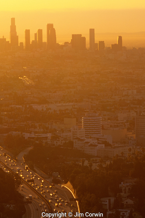 Los Angeles skyline sunset view from Mulholland Drive barely visible because of the heavy smog in the air Los Angeles California USA.
