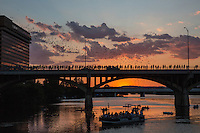 People watching the nightly bat exodus from the Ann W. Richards Congress Avenue Bat Bridge at sunset in Austin, Texas. The Mexican free-tailed bat, also known as the Brazilian free-tailed bat roost under the Congress Avenue Bridge ten blocks south of the Texas State Capitol. It is the largest urban bat colony in the world.