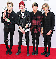 LOS ANGELES, CA, USA - NOVEMBER 23: Michael Clifford, Luke Hemmings, Ashton Irwin, Calum Hood, 5 Seconds of Summer arrive at the 2014 American Music Awards held at Nokia Theatre L.A. Live on November 23, 2014 in Los Angeles, California, United States. (Photo by Xavier Collin/Celebrity Monitor)