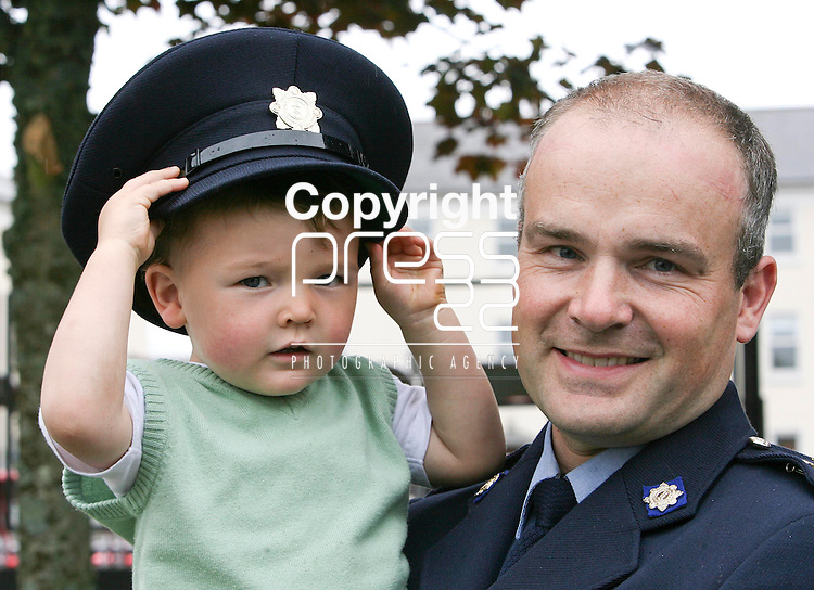 310708 Garda Niall Dillon from Navan with his 2 year old son Eoghan during the Graduation Ceremony at the Garda College Templemore today.Pic Arthur Ellis/Press22.