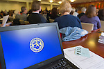 Feb. 25, 2013 - Mineola, New York, U.S. - The Seal of Nassau County, NY, is on laptop screen at Nassau County Legislature meeting mainly about the controversial Redistricting Map proposed by Republicans. The legislature postponed the vote on the map shortly before 1 AM the morning of February 26, nearly 12 hours after the meeting started on 1:30 PM Feb. 25. Over 100 members of the public submitted Speakers Forms, and the meeting was so well attended that some visitors had to stand in the chambers or watch in other rooms of the legislative building.