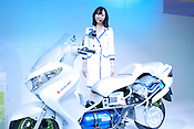 A model introduces a Suzuki scooter powered with a fuel cell (using hydrogen) at the Nagoya Motor Show.