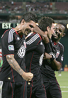 Chris Pontius #13  of D.C. United is congatulated on scoring the second goal by Santino Quaranta #25 and Luciano Emilio #11 during an international friendly match against A.C. Milan at RFK Stadium, on May 26 2010 in Washington DC. United won 3-2.