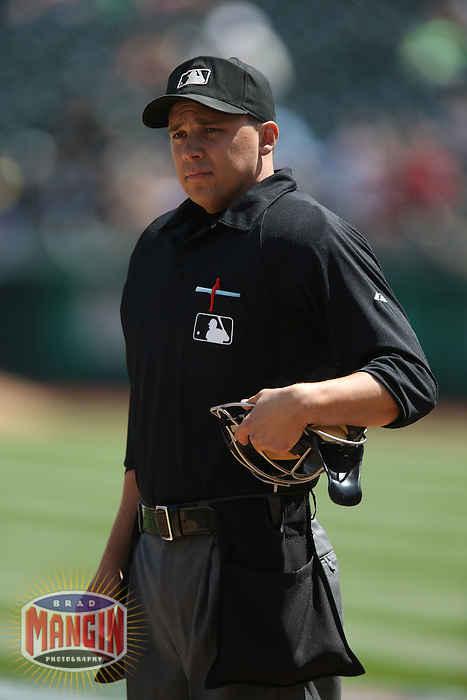 OAKLAND, CA - APRIL 9:  Home plate umpire Adam Hamari works the game between the Texas Rangers and Oakland Athletics at O.co Coliseum on Thursday, April 9, 2015 in Oakland, California. Photo by Brad Mangin