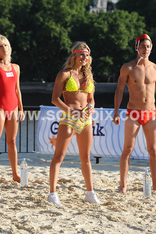 **ALL ROUND PICTURES FROM SOLARPIX.COM**.**NO UK NEWSPAPER PUBLICATION**.**UK MAGAZINE & SUPPLEMENT PUBLICATION ONLY** AND NO PUBLICATION IN AUSTRALIA, FRANCE, GERMANY, ITALY AND SCANDINAVIA** .The embankment on the River Thames in London this morning was turned into Bondi beach to promote G'day UK. A campaign  to encourage British companies and consumers  to invest in, work in, and holiday in  Australia. London, UK. 24 June 2009..This pic: Bondi London..JOB REF: 9327 SFE       DATE: 24_06_2009.**MUST CREDIT SOLARPIX.COM OR DOUBLE FEE WILL BE CHARGED**.**ONLINE USAGE FEE GBP 50.00 PER PICTURE - NOTIFICATION OF USAGE TO PHOTO @ SOLARPIX.COM**.**CALL SOLARPIX : +34 952 811 768 or LOW RATE FROM UK 0844 617 7637**