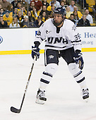 Phil DeSimone (UNH - 39) - The Merrimack College Warriors defeated the University of New Hampshire Wildcats 4-1 in their Hockey East Semi-Final on Friday, March 18, 2011, at TD Garden in Boston, Massachusetts.