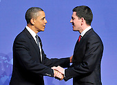 United States President Barack Obama welcomes David Miliband, Secretary of State for Foreign and Commonwealth Affairs of the United Kingdom to the Nuclear Security Summit at the Washington Convention Center, Monday, April 12, 2010 in Washington, DC. .Credit: Ron Sachs / Pool via CNP