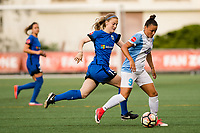 Seattle, WA - Sunday, May 21, 2017: Kristen McNabb and Camila Martins Pereira during a regular season National Women's Soccer League (NWSL) match between the Seattle Reign FC and the Orlando Pride at Memorial Stadium.