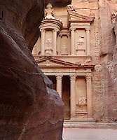 Treasury of the Pharaohs or Khazneh Firaoun, 100 BC - 200 AD, seen from the end of the Siq, Petra, Ma'an, Jordan. Originally built as a royal tomb, the treasury is so called after a belief that pirates hid their treasure in an urn held here. Carved into the rock face opposite the end of the Siq, the 40m high treasury has a Hellenistic facade with three bare inner rooms. Petra was the capital and royal city of the Nabateans, Arabic desert nomads. Picture by Manuel Cohen