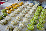 Mandoo in a variety of colors and flavors are a favorite item at the open air market in Wonju, Korea