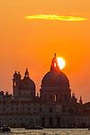 The sun setting behind the Chiesa della Salute. taken from Riva degli Schiavoni.