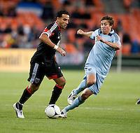 Dwayne De Rosario, Matt Besler.  Sporting KC defeated D.C. United, 1-0, at RFK Stadium in Washington, DC.