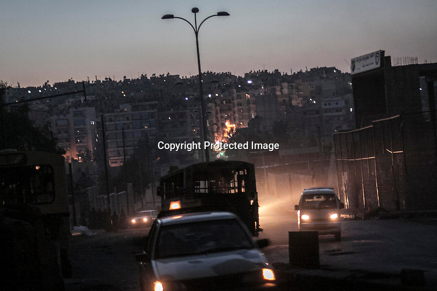 In this Tuesday, Oct. 30, 2012 photo, a rebel check point is viewed in the nearby Bustan Al-Pasha neighborhood, the boundary of the controlled area by rebel fighters at the northeast limit of the Kurdish controlled area of Sheikh Maksoud in Aleppo, the Syrian's largest city. (AP Photo/Narciso Contreras).