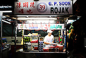 A stall owner prepares Rojak, a dish Penang is famous for at a Chinese Hawker stall in the UNESCO heritage city of Georgetown in Penang, Malaysia. Photo: Sanjit Das/Panos
