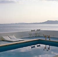 This tranquil swimming pool is surrounded by a blue-tiled terrace and overlooks the Mediterranean and the coast of Majorca