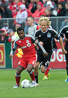 24 March 2012: Toronto FC midfielder Julian de Guzman #6 and San Jose Earthquakes forward Steven Lenhart #24 in action during the first half in a game between the San Jose Earthquakes and Toronto FC at BMO Field in Toronto..