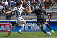 Mexico City September 23, 2014. The Paraguayan Dante Lopez (right) attacks the ball to the defense of Colombia John Medina, during the final day of the regular season of league MX. Encounter in which Pumas won 4-2 at Monterrey to classify quarterfinals. Photo by Miguel Angel Pantaleon/VIEWpress
