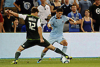 Milos Stojcev (88)  midfielder Sporting KC tackled by David Horst (12)  defender Portland Timbers... Sporting Kansas City defeated Portland Timbers 3-1 at LIVESTRONG Sporting Park, Kansas City, Kansas.