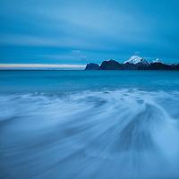Incoming waves flows over Storsandnes beach, Flakstadøy, Lofoten Islands, Norway