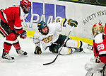 12 December 2009: University of Vermont Catamount forward Jack Downing, a Junior from New Canaan, CT, is upended during game action against the St. Lawrence University Saints at Gutterson Fieldhouse in Burlington, Vermont. The Catamounts shut out their former ECAC rival Saints 3-0. Mandatory Credit: Ed Wolfstein Photo