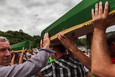 The coffins with the human remains of Nermin (19) and Samir (23) Selimovic who were killed during the 1995 Srebrenica massacre are carried to their resting place.