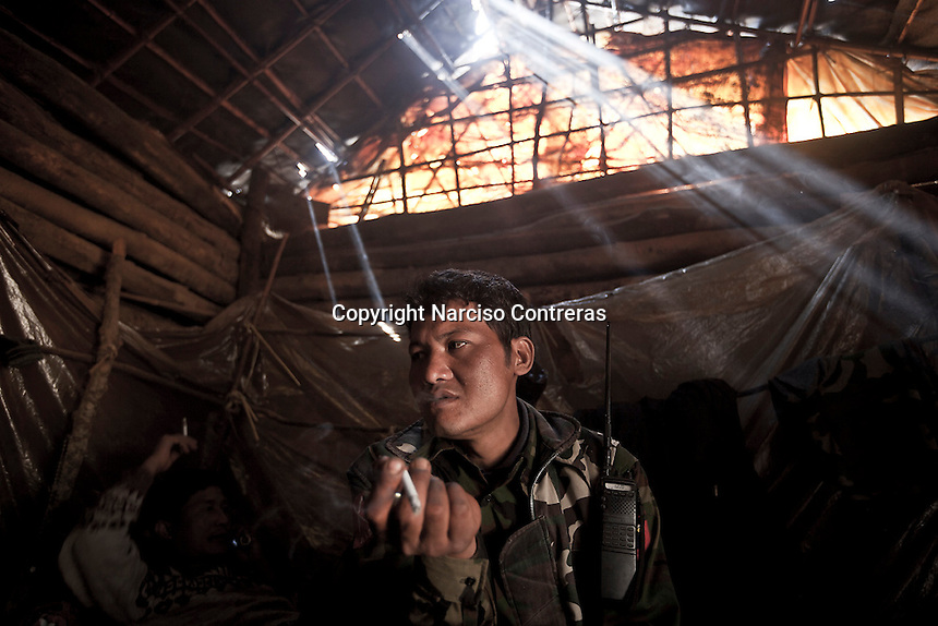 KIA cobra soldiers take a rest inside a bunker in Jan Mai front line as they keep guarding the post, which was lost by Burmese army during heavy fighting last months. Jan Mai outpost is located at the top of the mountains, some kilometers away from Maiya Jang city. The KIA positions around Maiya Jang city have been attacked by shelling and heavy artillery during months. Fierce clashes have taken place since the ceasefire was broken out by the Burmese army last June 2011. During months the fighting were spread out along the Kachin State leaving more than 40,000 displaced persons and refugees (a conservative estimating) in accord with the humanitarian aid groups.
