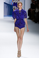 Marique Schimmel walks runway in an indigo moire peplum vest over indigo textured gauze top Indigo stretch cotton boy shorts.by Vera Wang, for the Vera Wang Spring 2012 collection, during Mercedes-Benz Fashion Week Spring 2012.