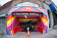 Entrance to the 900-foot long 191st Subway station connecting tunnel, painted by Queen Andrea and newly decorated by artists hired by the New York City Dept. of Transportation on Thursday, May 21, 2015. The artists, COPE2, Queen Andrea, Nick Kuszyk, Cekis and Jessie Unterhalter and Katey Truhn were chosen in a competitive process by the DOT. The tunnel has recently received upgraded LED lighting and with the addition of the murals has been turned into an art gallery. (© Richard B. Levine)