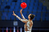 Viktoriya Mazur of Ukraine performs cossack leap with ball at 2010 Pesaro World Cup on August 28, 2010 at Pesaro, Italy.  Photo by Tom Theobald.