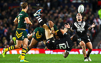 Picture by Alex Whitehead/SWpix.com - 30/11/2013 - Rugby League - Rugby League World Cup Final - New Zealand v Australia - Old Trafford, Manchester, England - New Zealand's Sonny Bill Williams is tackled by Australia's Sam Thaiday.