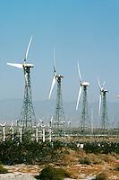 WINDMILLS<br /> Electrical Wind Turbines<br /> Wind farm in Indio, CA. Renewable energy from eolian power. Wind turbine generates electricity.