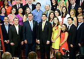 Mitt Romney, Republican Presidential Candidate and Paul Ryan, Republican Vice Presidential Candidate participate in a group photo with staff prior to the start of the day's proceedings at the 2012 Republican National Convention in Tampa Bay, Florida on Thursday, August 30, 2012.  .Credit: Ron Sachs / CNP.(RESTRICTION: NO New York or New Jersey Newspapers or newspapers within a 75 mile radius of New York City)
